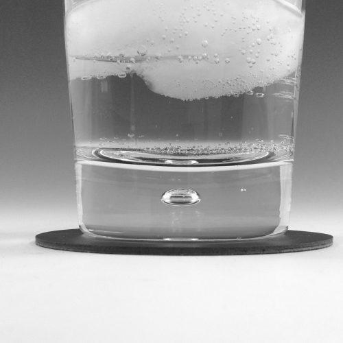 Black Linoleum Drink Coaster with Glass